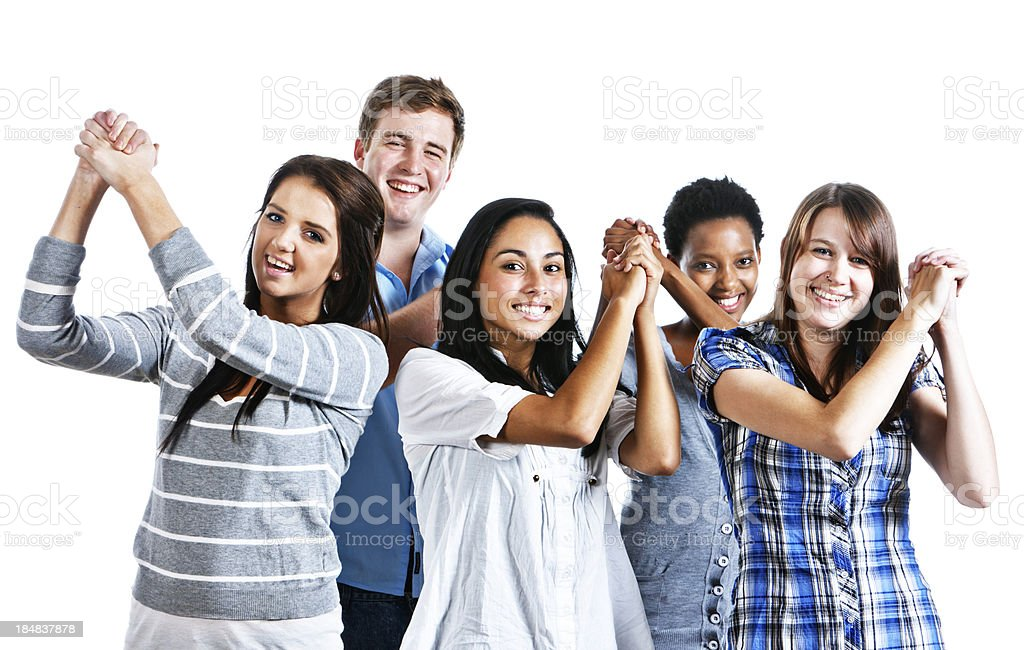 Five smiling young people congratulate themselves raising clasped hands royalty-free stock photo