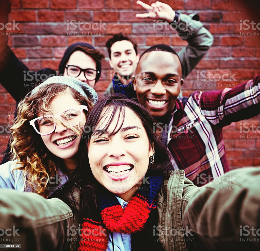 Five smiling youngsters take happy selfie stock photo