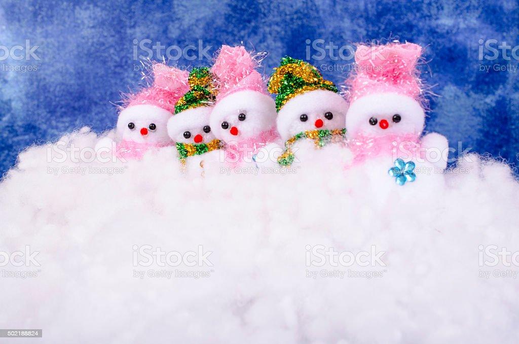 Five snowmen in the snow. stock photo