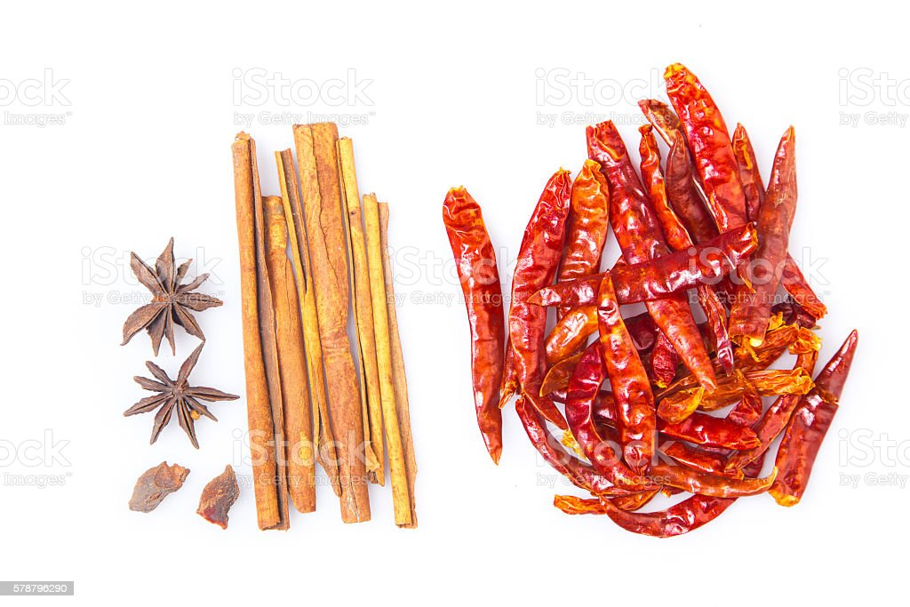 Five spices and dried chili peppers on white background stock photo