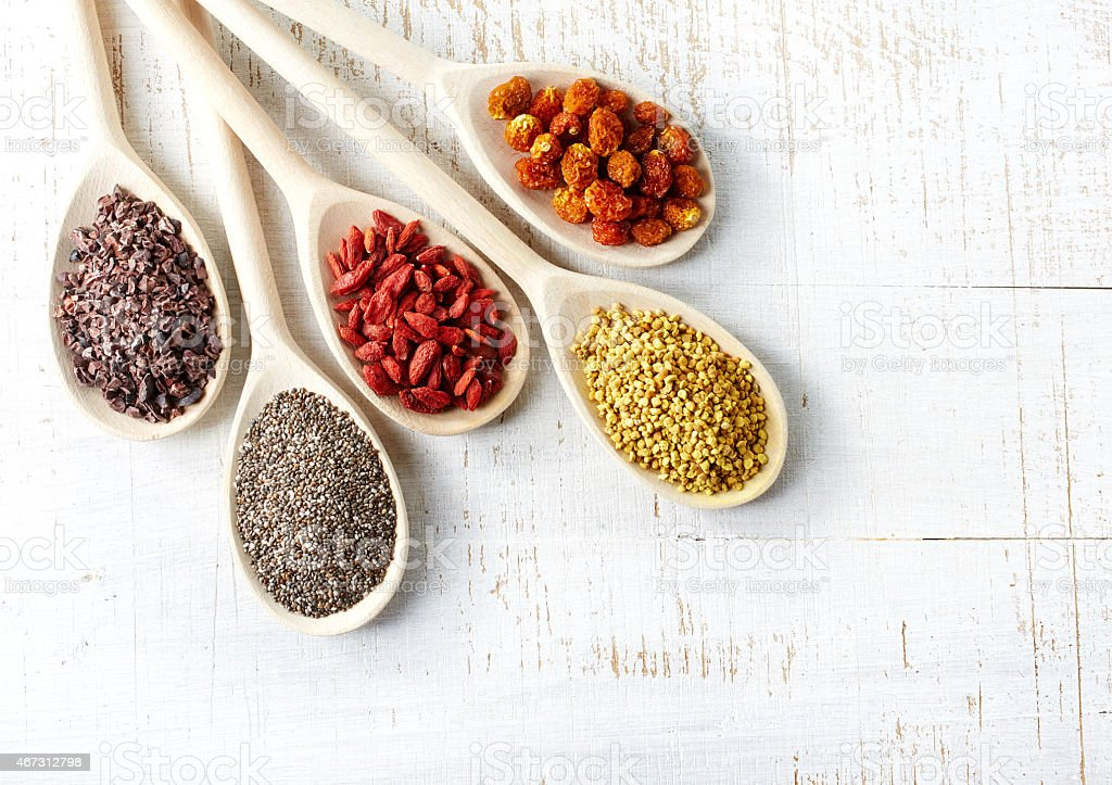 Five spoons full of healthy superfoods stock photo