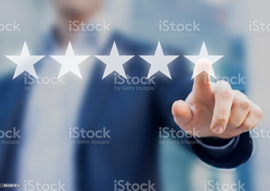 Five stars (5) rating with a businessman touching screen stock photo