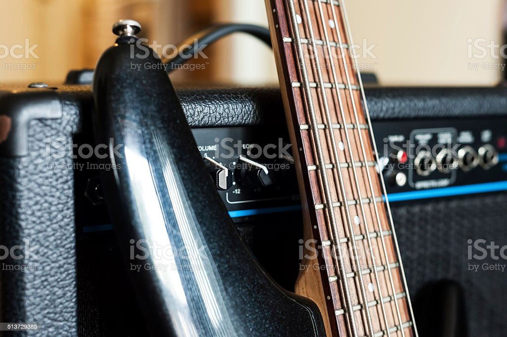 Five string electric bass guitar fingerboard and combo close up stock photo