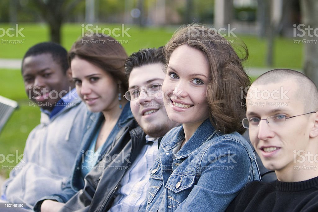 Five students on bench stock photo