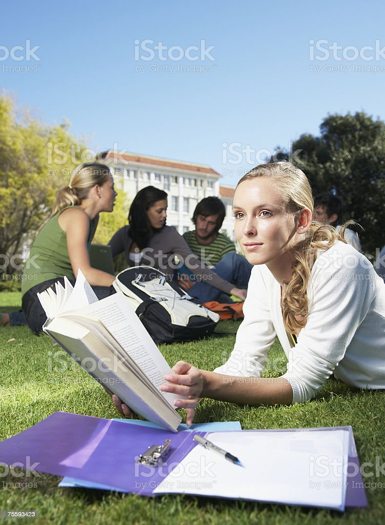 Five students studying outdoors royalty-free stock photo