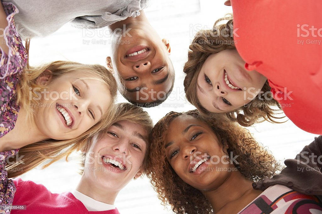 Five Teenage Friends Looking Down Into Camera stock photo