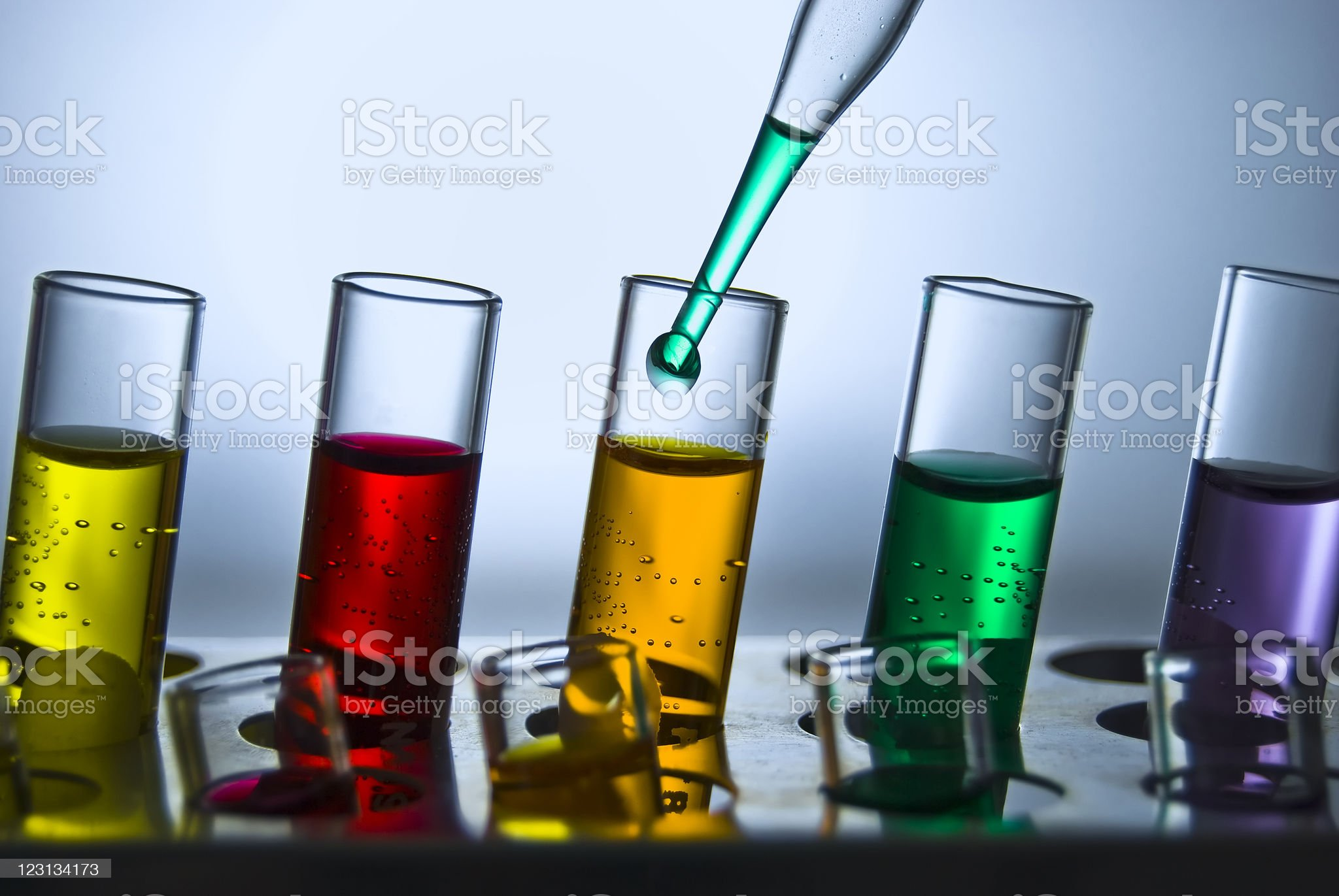 Five test tubes with various colorful liquids royalty-free stock photo