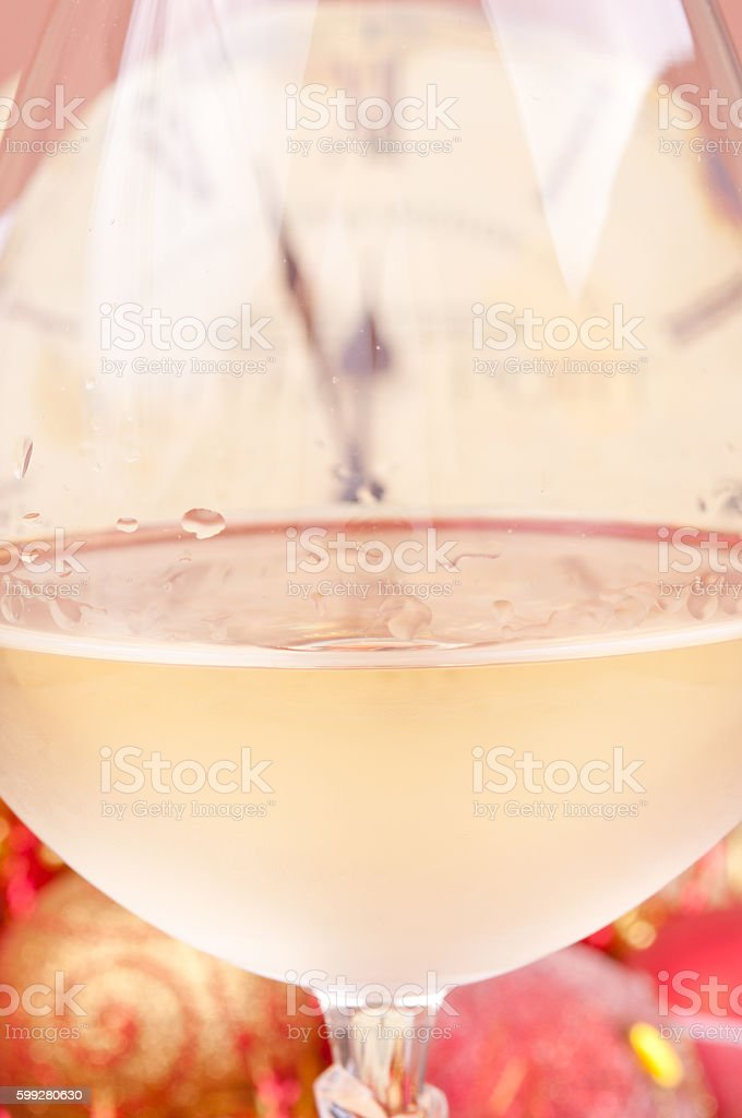 Five to twelve through glass of a white wine stock photo