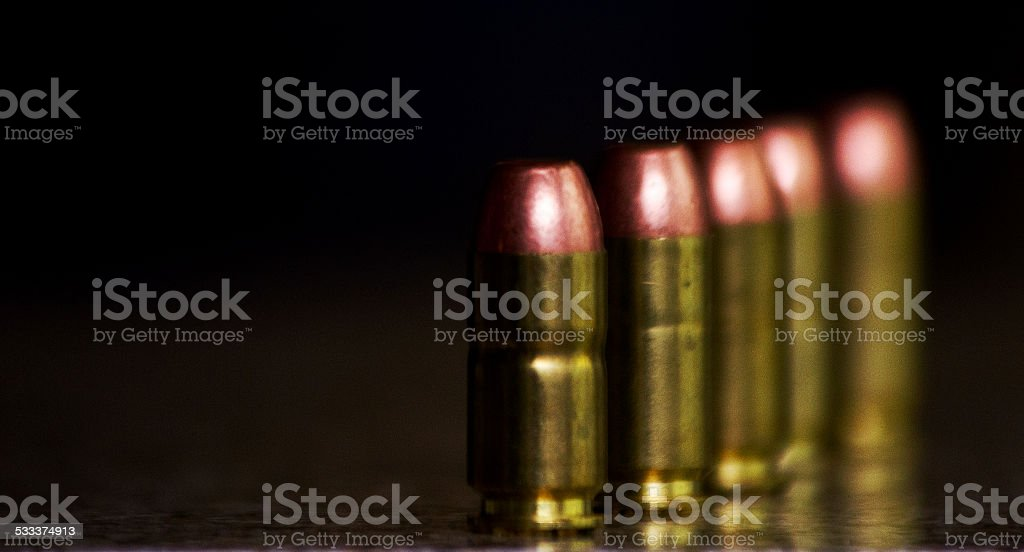 Five unfired bullets stock photo