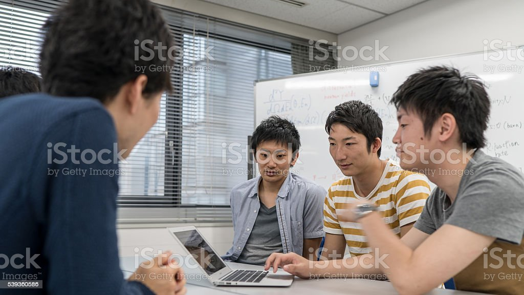 Five university students meeting at a room stock photo