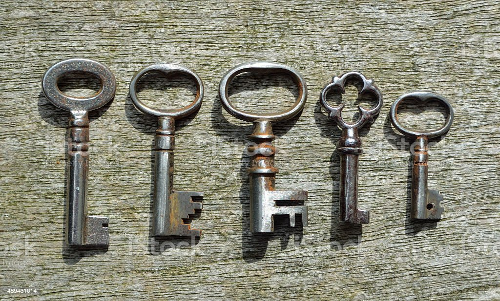 Five very small Antique  pipe Keys stock photo