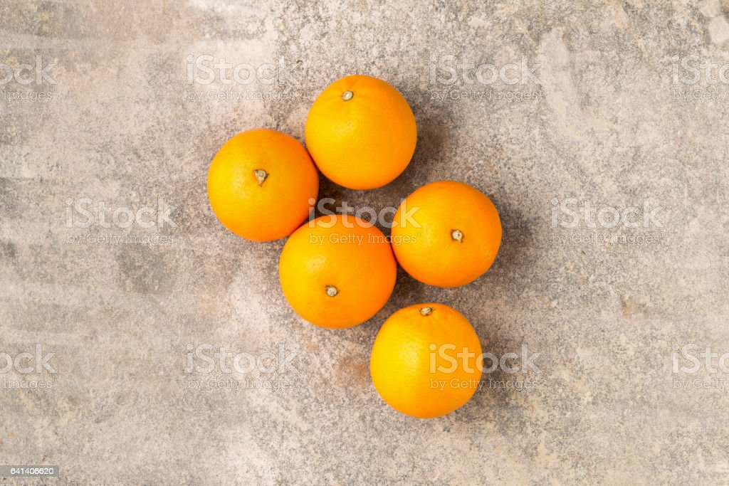 Five Whole Ripe Unpeeled Oranges stock photo