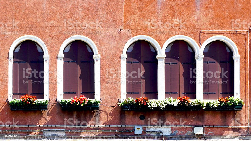 five wooden windows and ancient decay wall stock photo