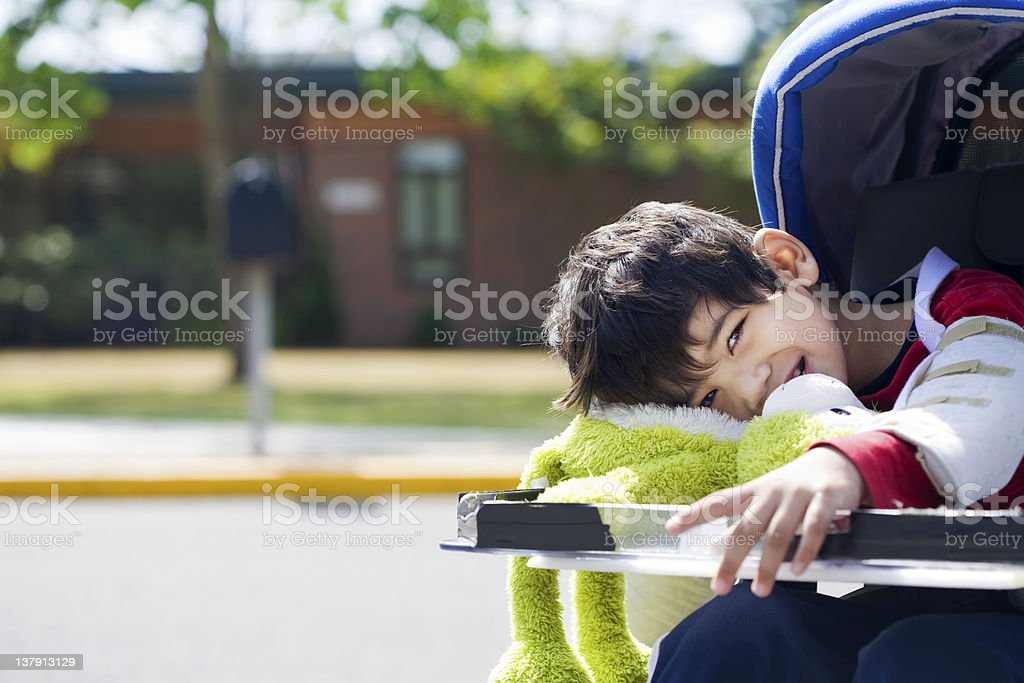Five year old disabled boy going to school royalty-free stock photo