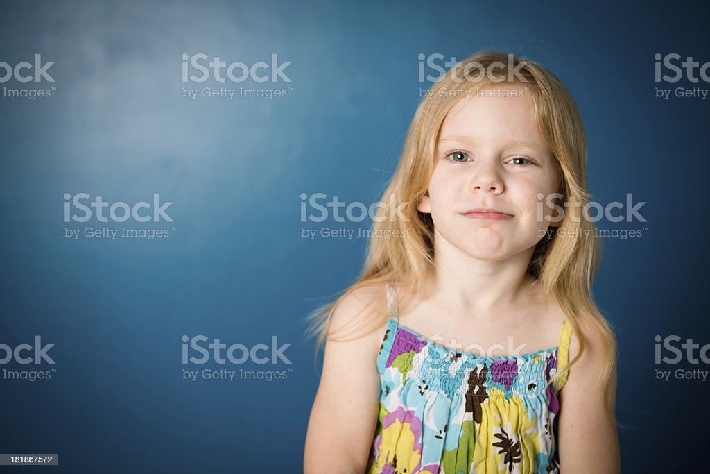 Five Year Old Girl With Unsure/Skeptical Look on Face royalty-free stock photo