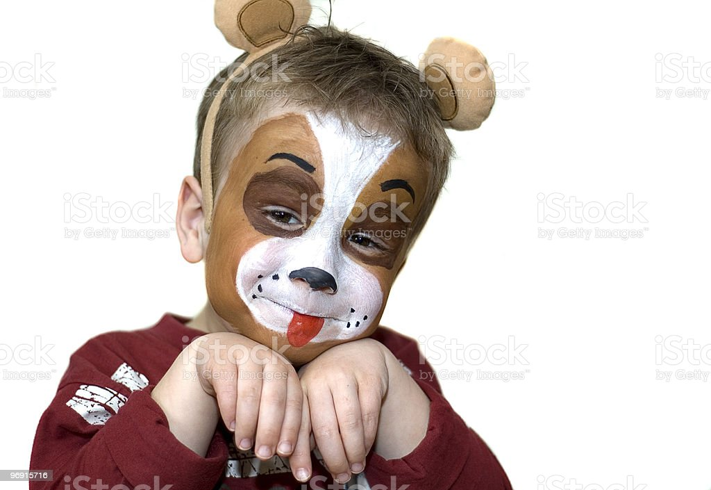 A five year old with a face painted like a dog stock photo