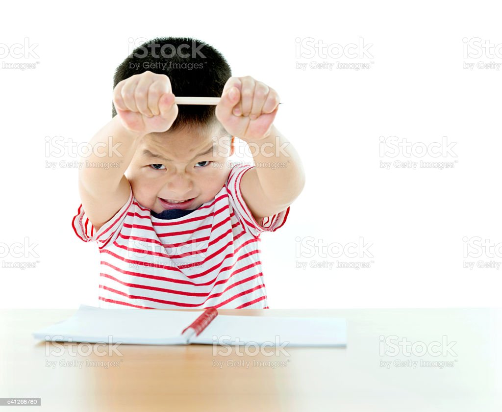 Five years old boy with a pencil stock photo