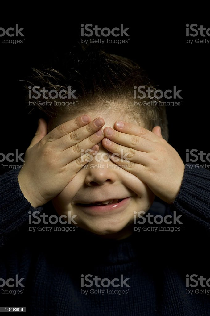 Five years old child with hands on his eyes royalty-free stock photo