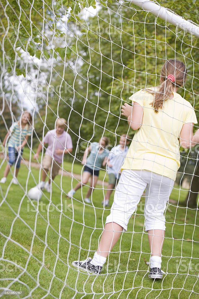 Five young friends playing soccer royalty-free stock photo