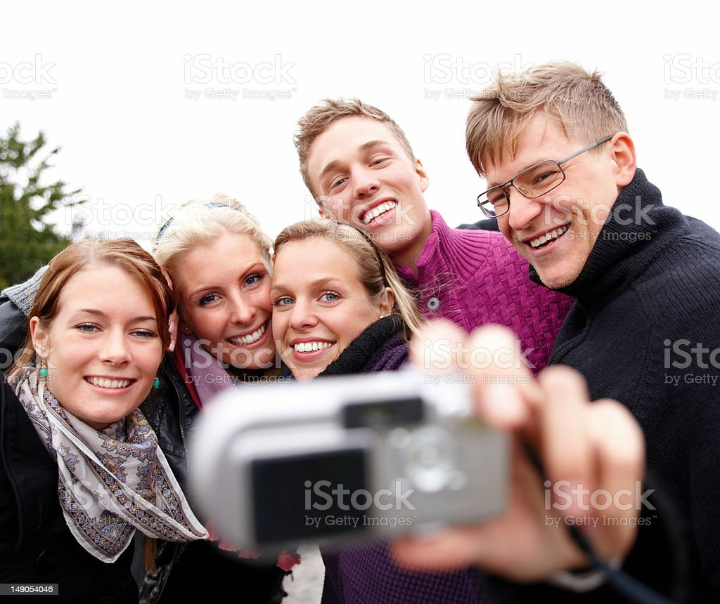 Five young friends taking self photograph royalty-free stock photo