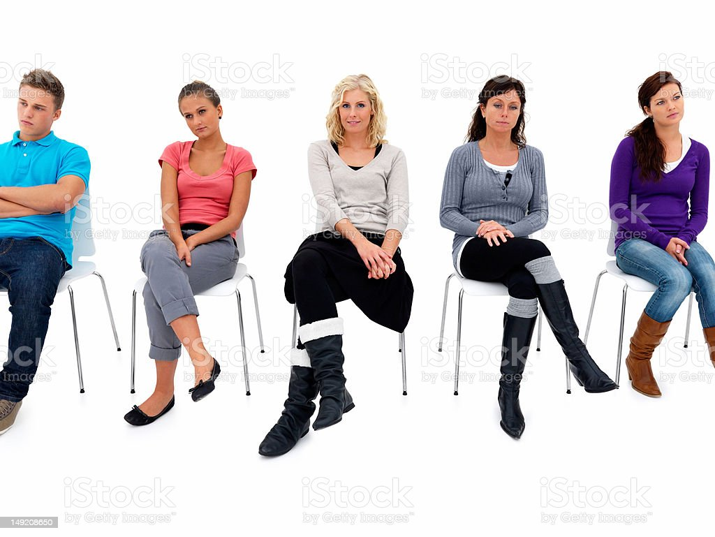 Five young men and women sitting on chairs royalty-free stock photo