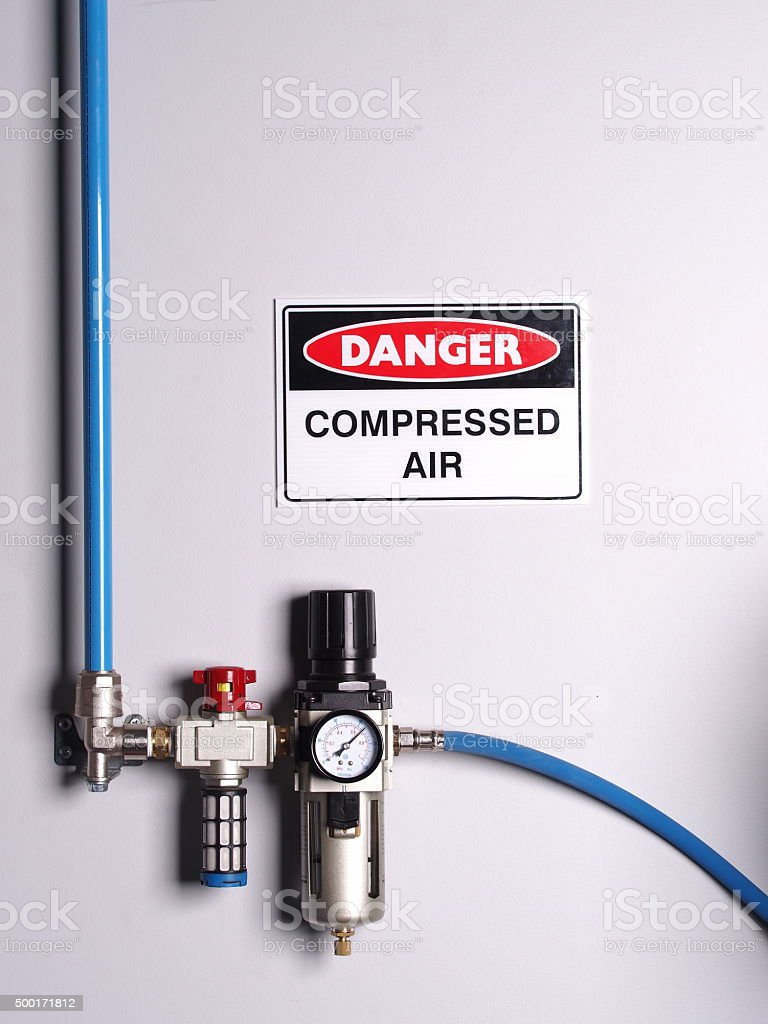 Fixed air line with pressure regulator, scale and flexibly hose stock photo