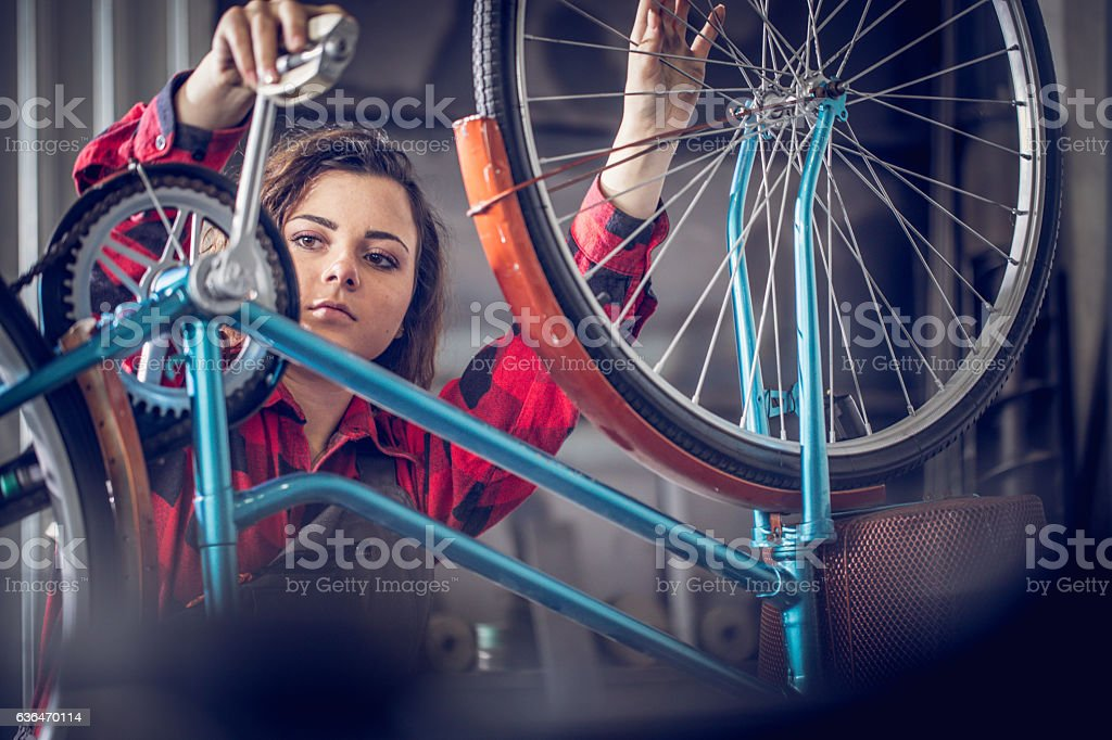Fixing a bike stock photo