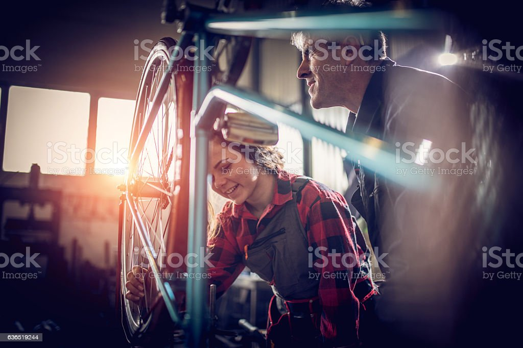 Fixing a bike stock photo