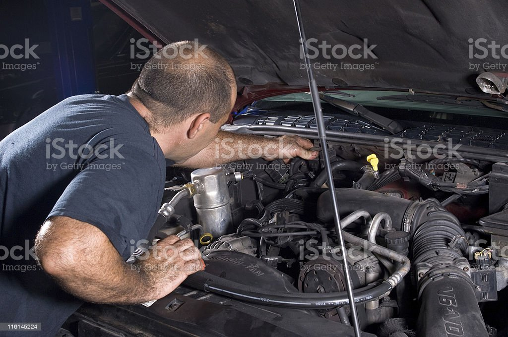 Fixing a car royalty-free stock photo