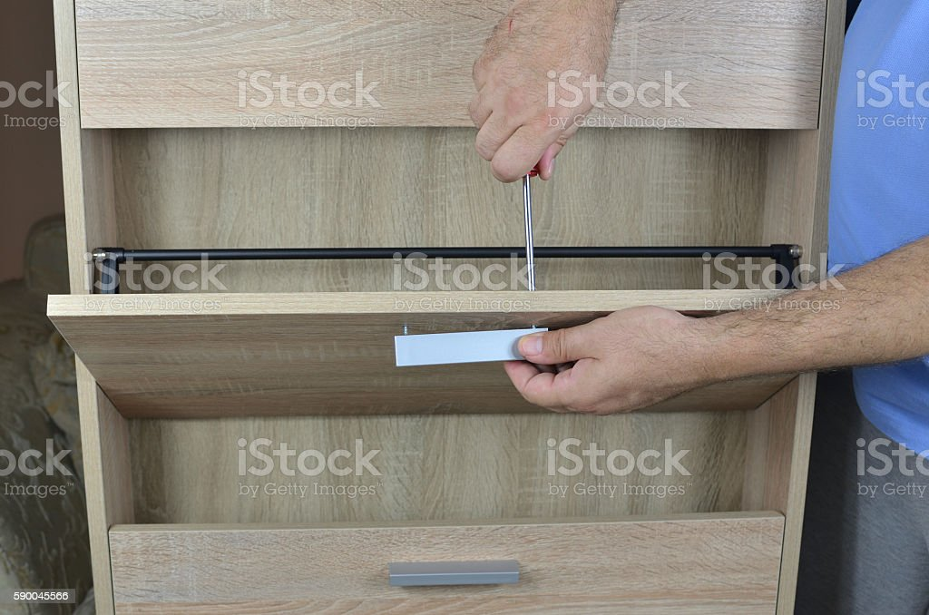 Fixing a Pull with Screwdriver stock photo