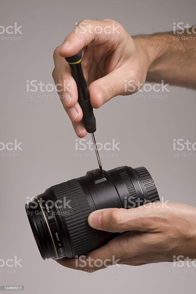 Fixing camera lens royalty-free stock photo