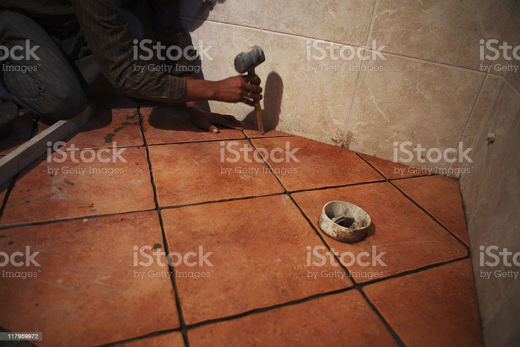Fixing Ceramics Tile royalty-free stock photo