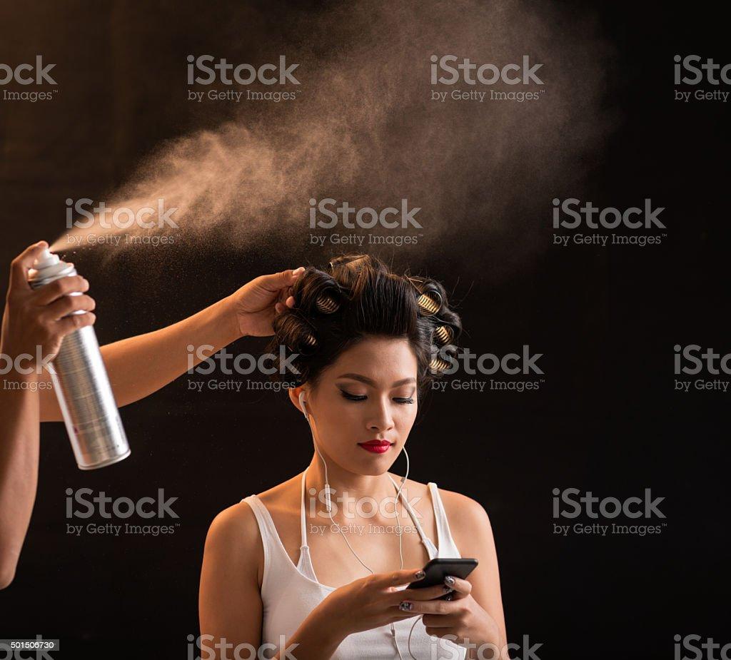 Fixing curls stock photo