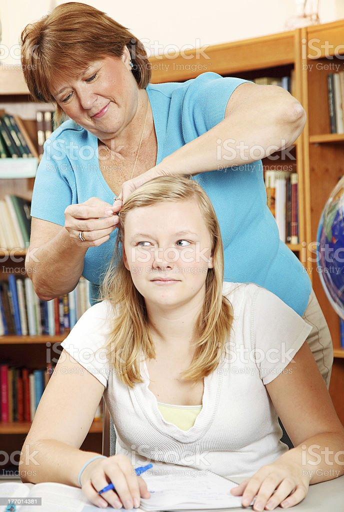 Fixing Daughter's Hair royalty-free stock photo