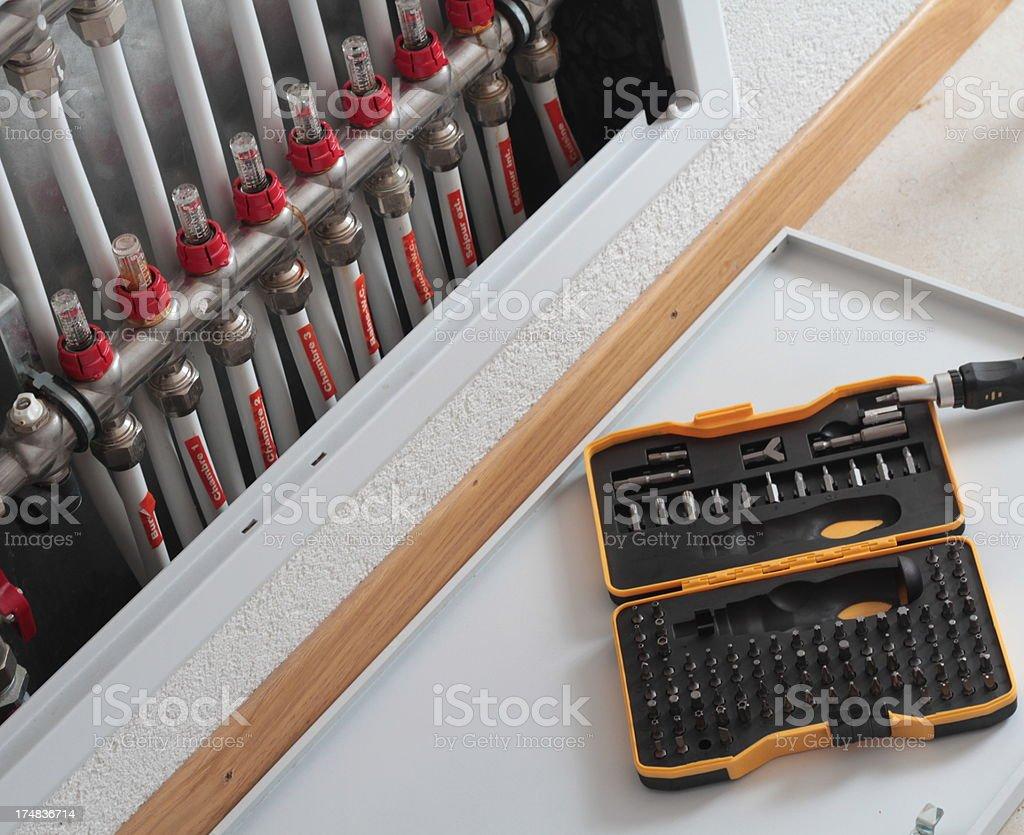 fixing floor heating system stock photo