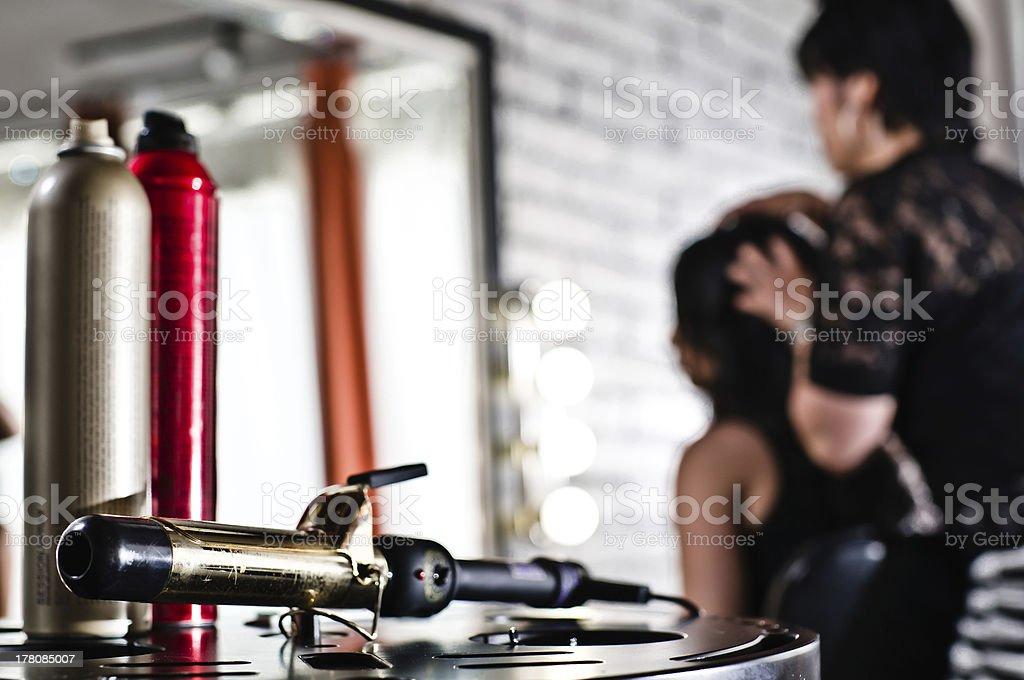 Fixing hair at Salon stock photo