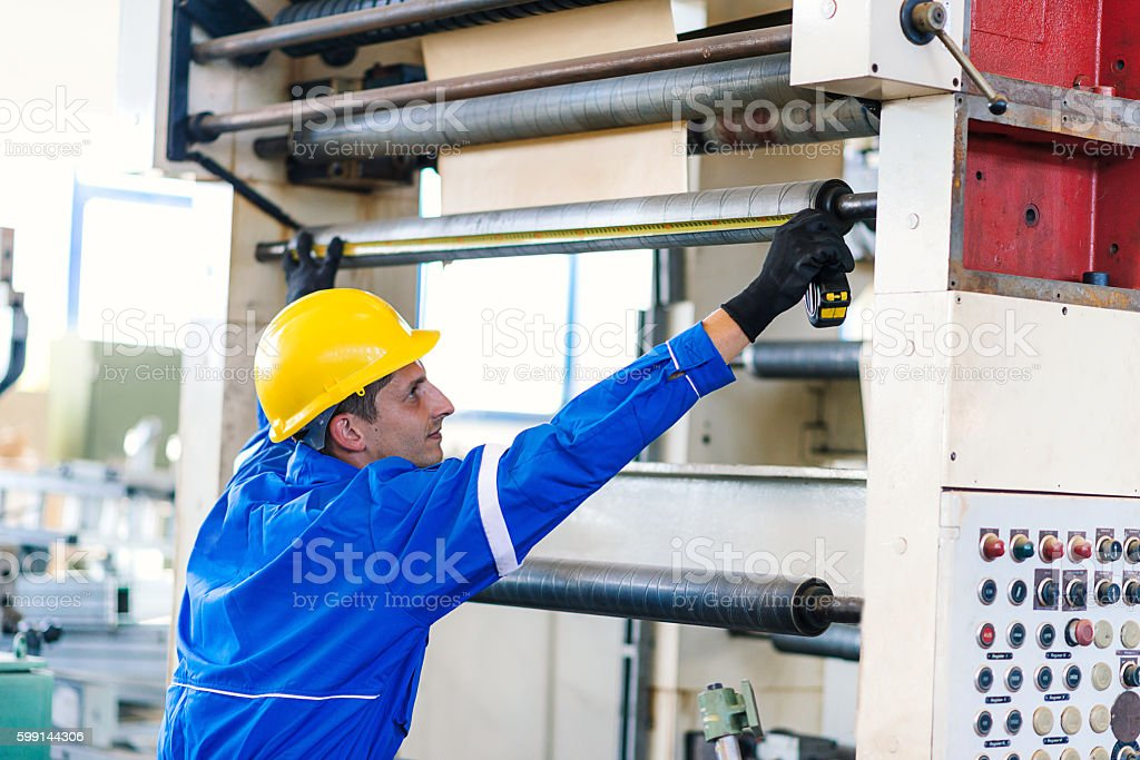 Fixing machine teeth and cog wheels in factory stock photo