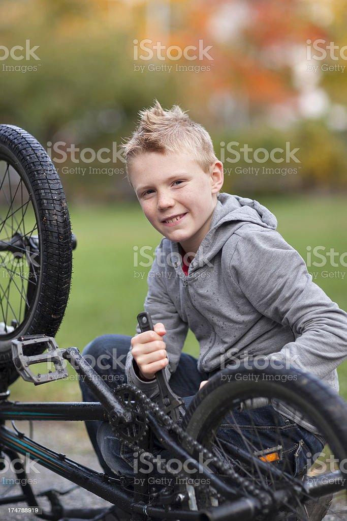 Fixing the bike stock photo