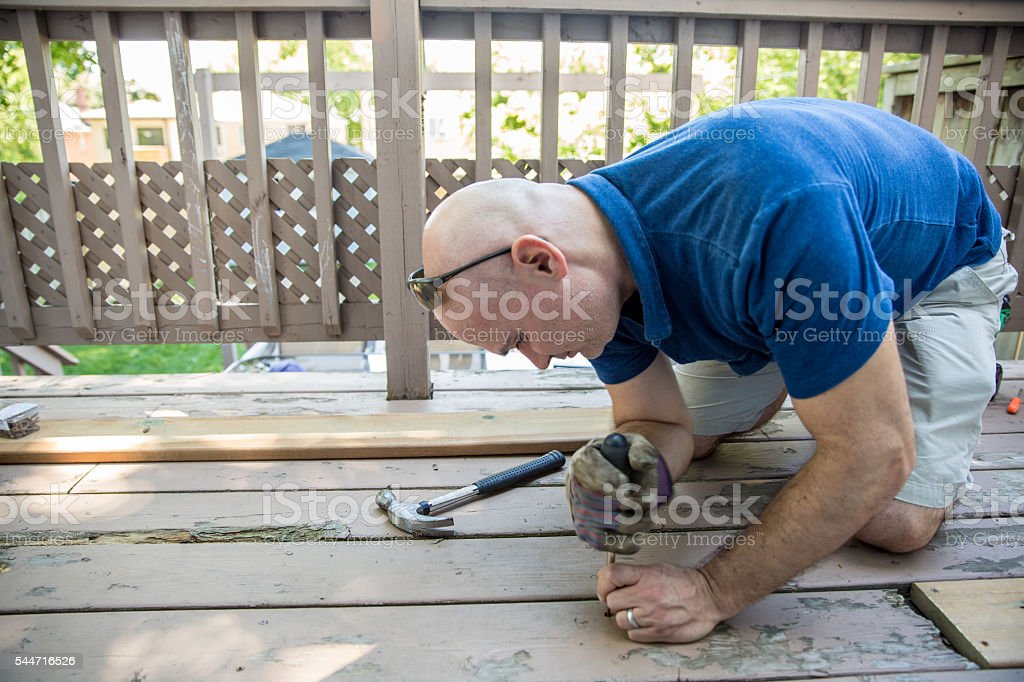 Fixing the deck stock photo