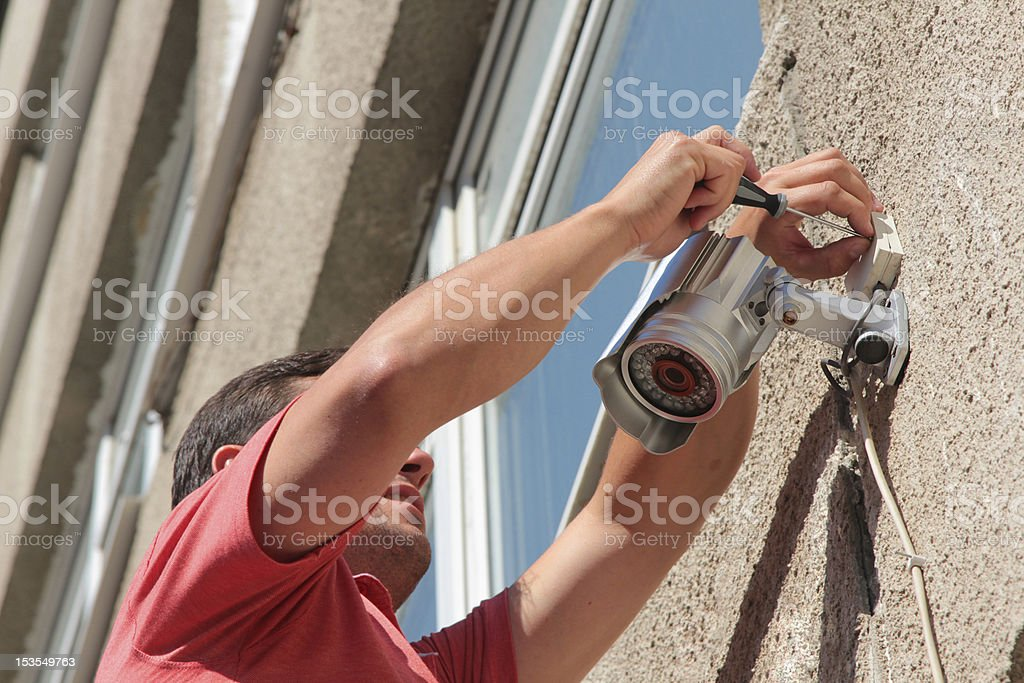 Fixing the security camera royalty-free stock photo