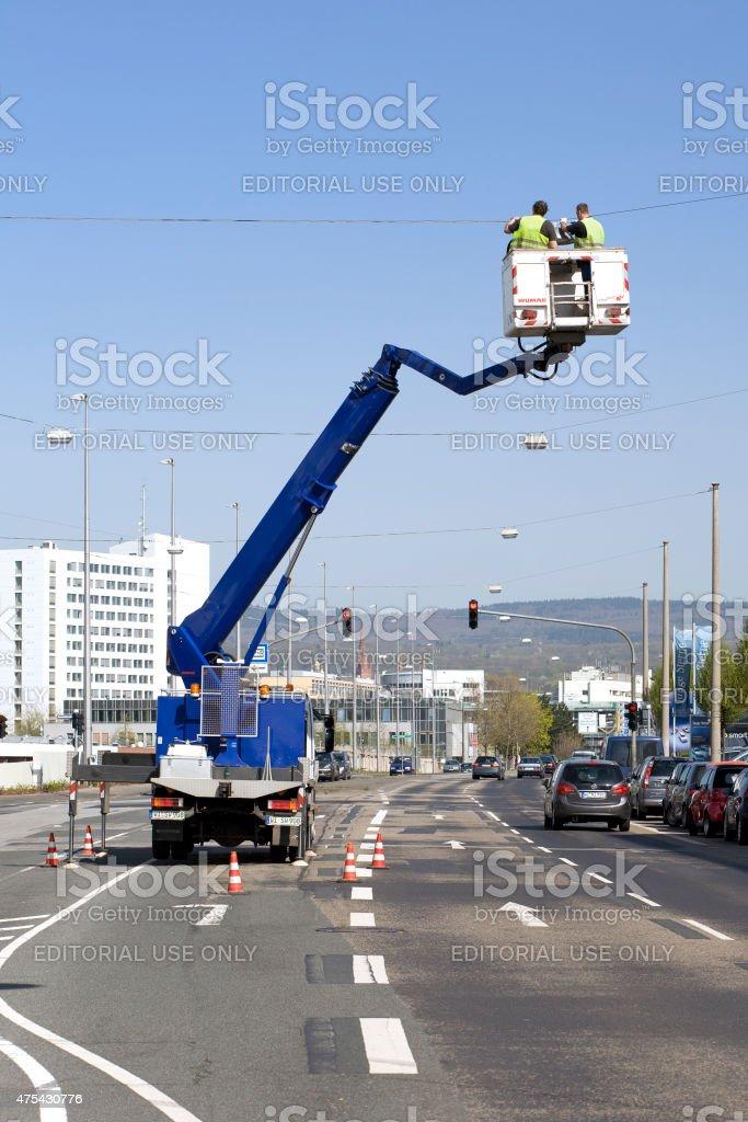Fixing the street lighting stock photo