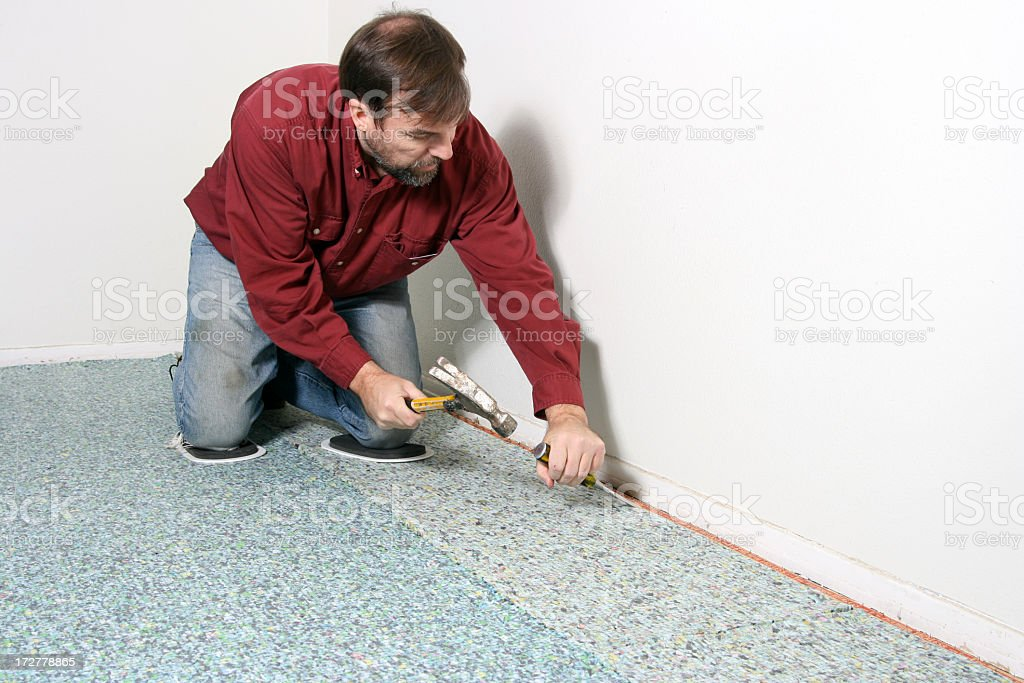 Fixing the Tack Strip stock photo