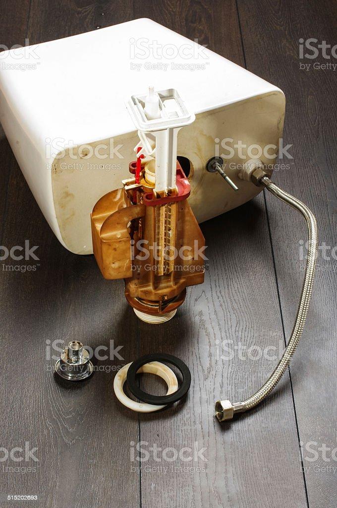 Fixing toilet flushing mechanism stock photo