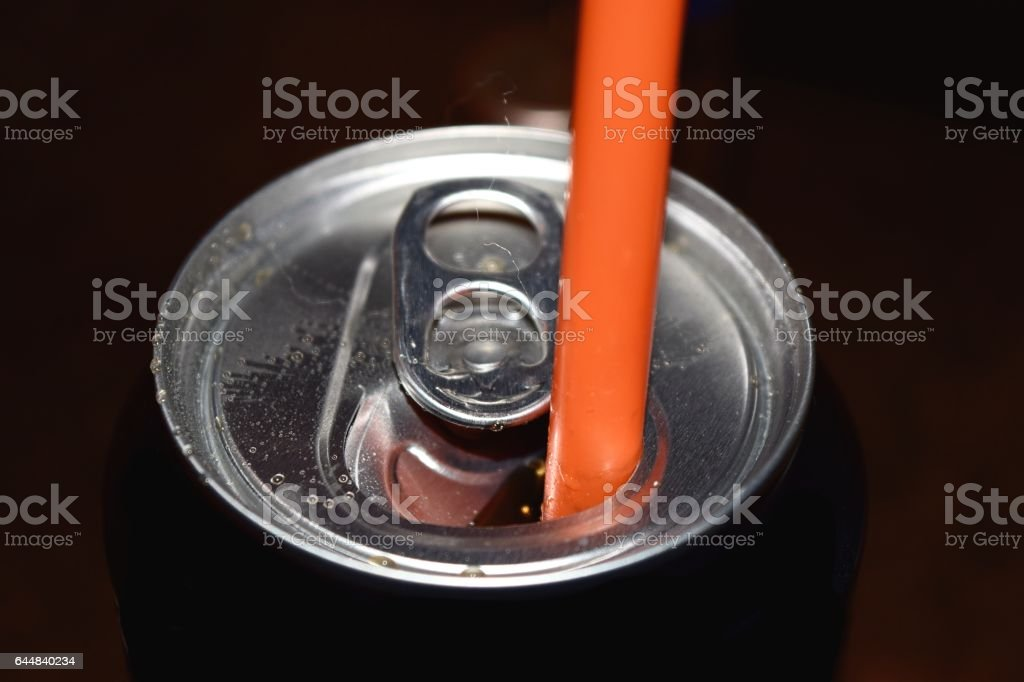 fizzy soda drink can with straw stock photo