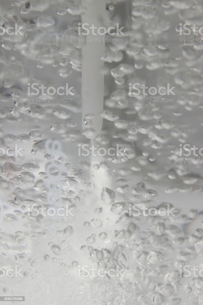Fizzy water image, soda water being carbonated with carbon-dioxide bubbles stock photo