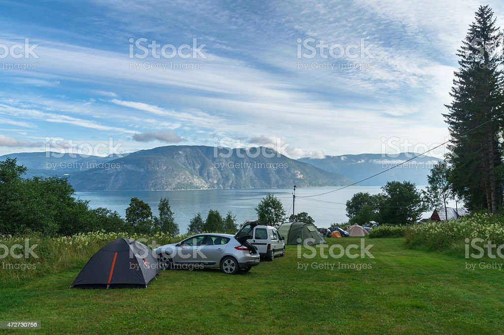 Fjord camping area with cars and tents stock photo