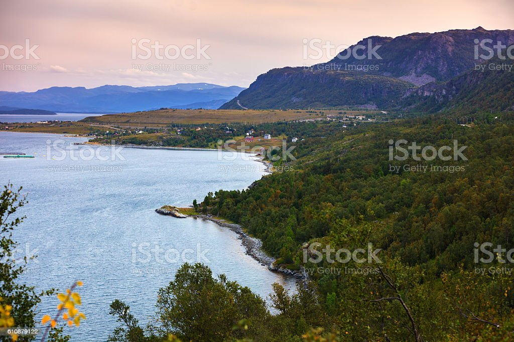 Fjord, rocky beach at sunset, Norway stock photo