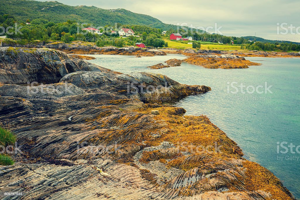 Fjord, rocky beach in cloudy weather, Norway stock photo