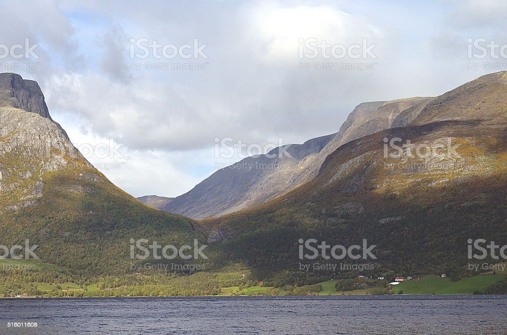 Fjord surrounded by high peaks in Norway stock photo