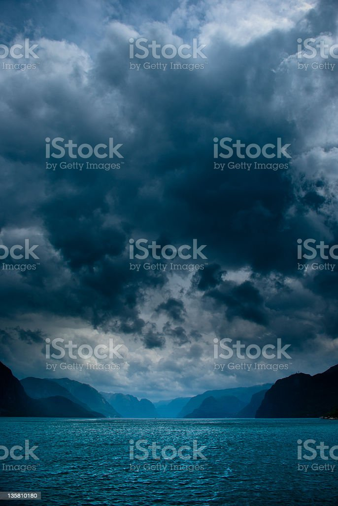 Fjord with dark clouds stock photo